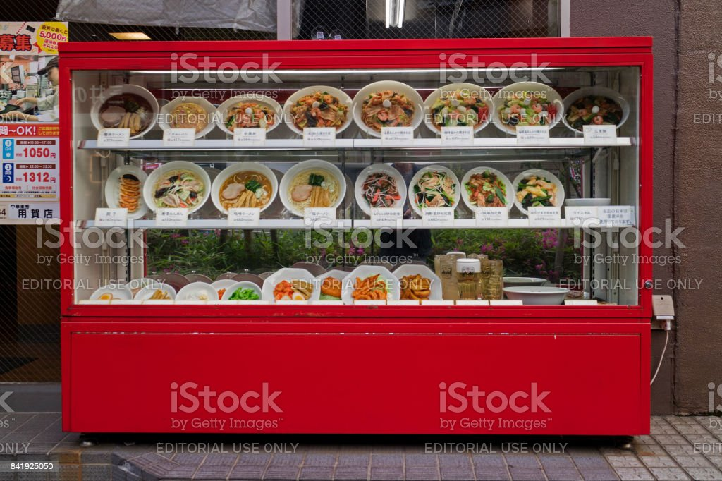 Display of replica food outdoors in front of a restaurant stock photo