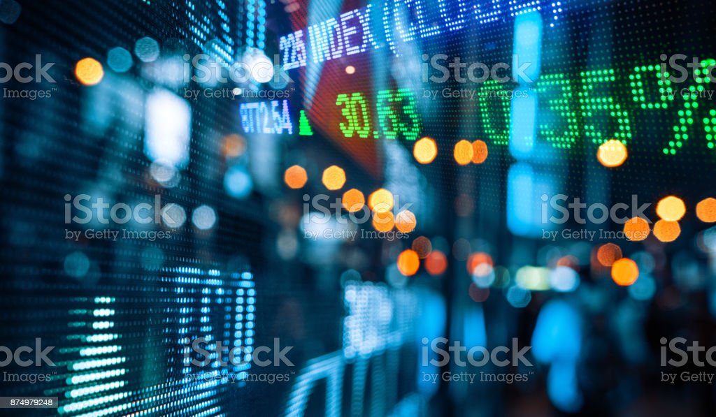 Display of Stock market quotes with city scene reflect on glass stock photo