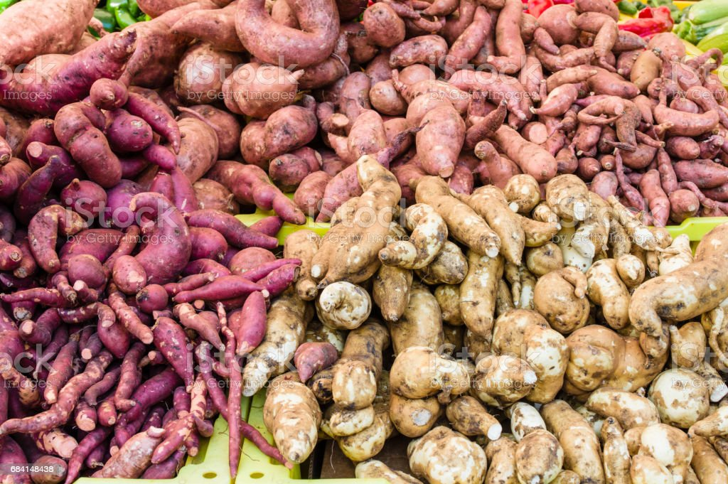 Display of sweet potatoes at the market royalty-free stock photo