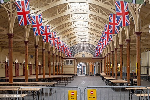 Barnstaple, England – July 2, 2020:  The Victorian pannier market adorned by rows of the national flag of the United Kingdom of Great Britain and Northern Ireland