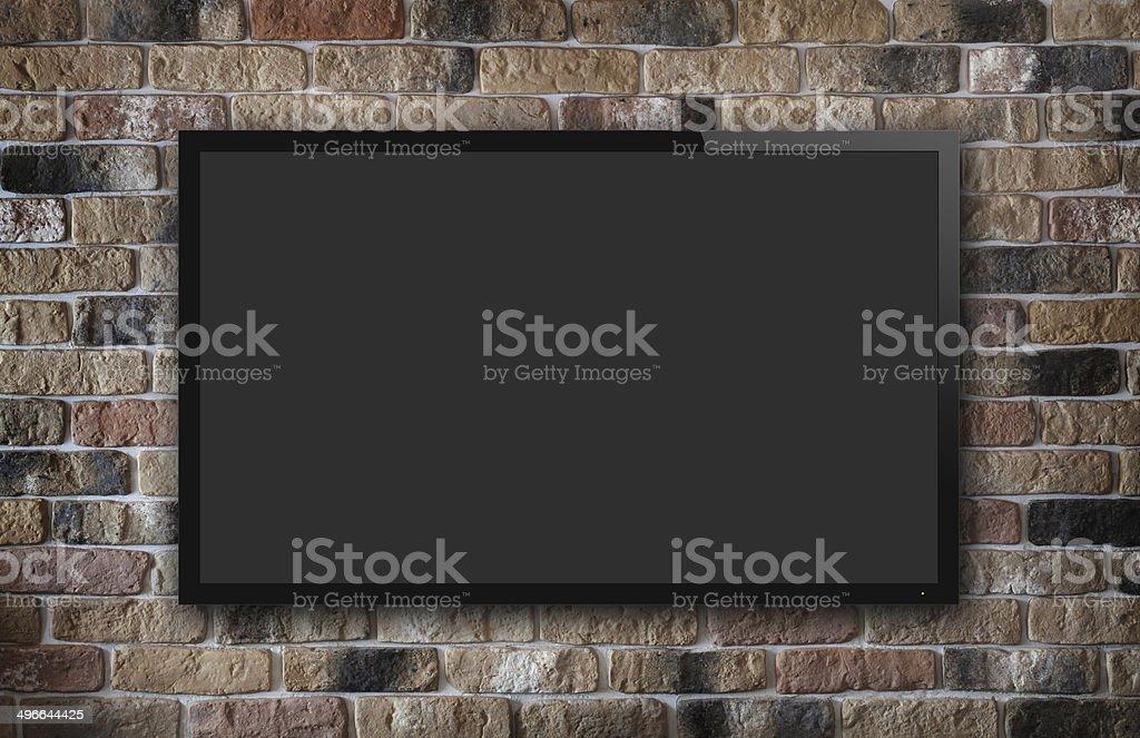 TV display on brick wall stock photo