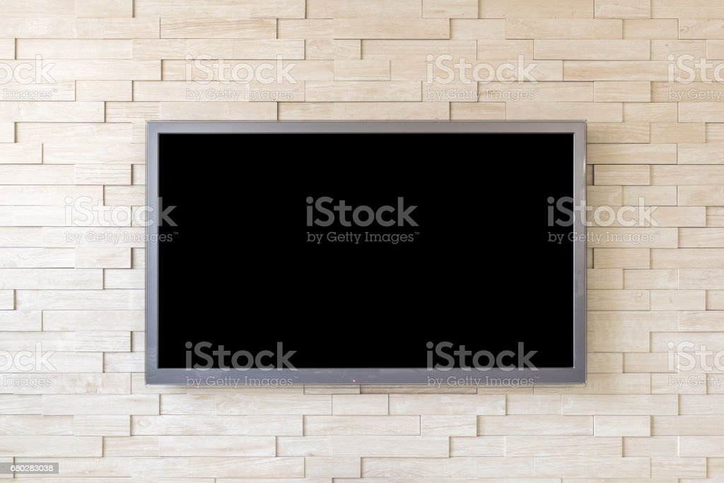TV display on modern brick wall background with black screen stock photo