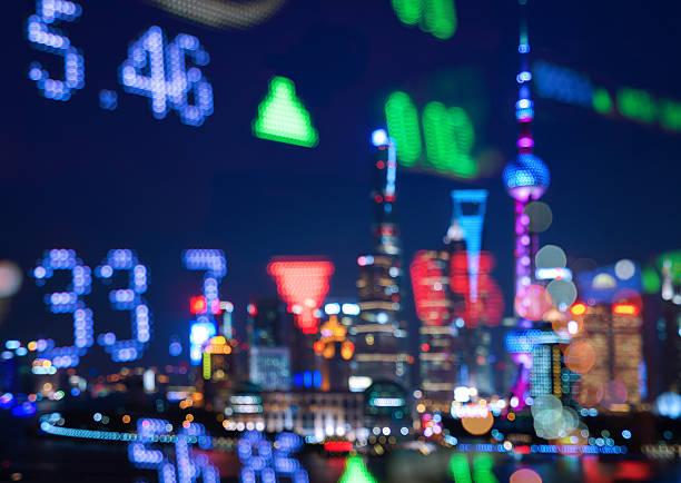 display stock market numbers and shanghai skyline background - hang seng index stock-fotos und bilder