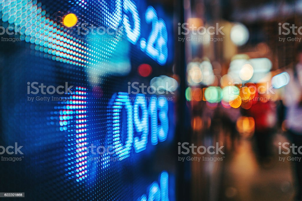 display stock market numbers with defocused street lights background stock photo