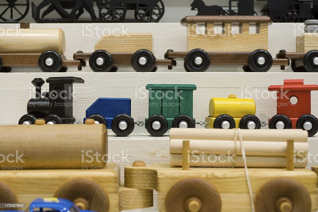 Display with wooden toy trains stock photo