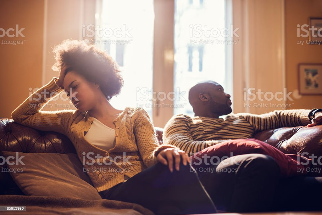 Displeased African American couple having difficulties in their relationship. stock photo