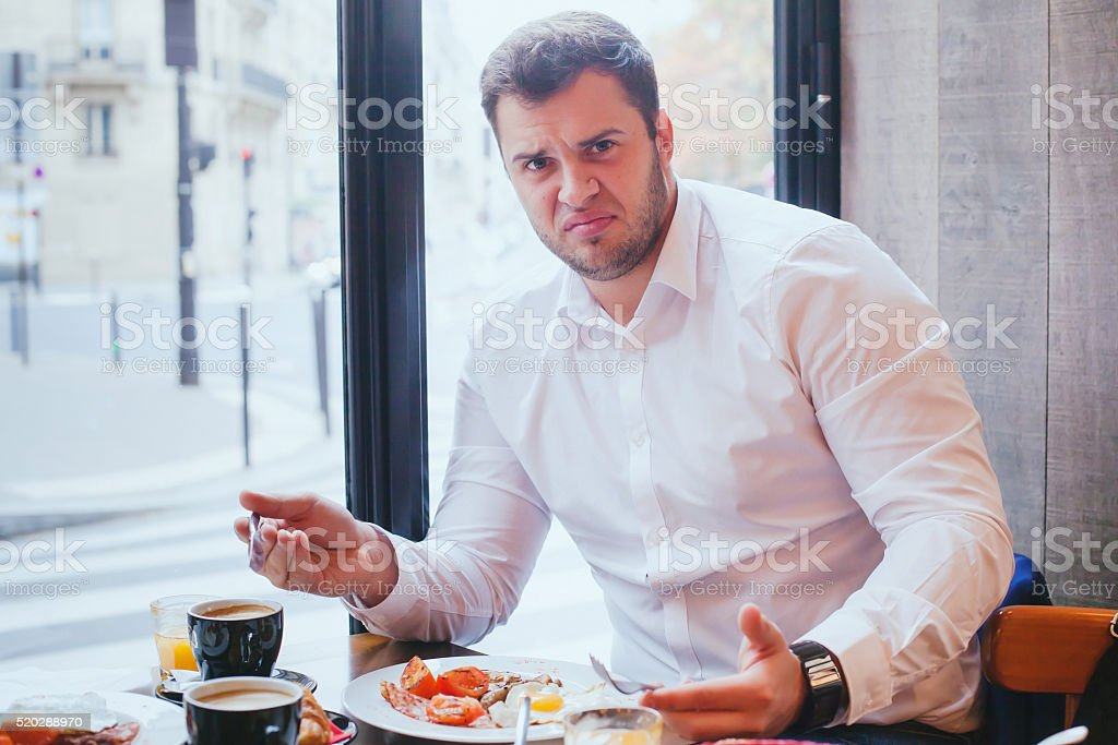 displeased angry customer in restaurant stock photo