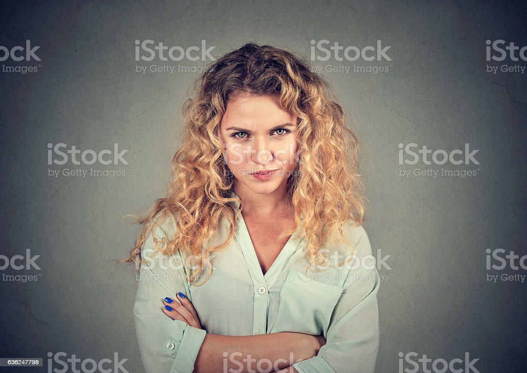 Displeased angry grumpy pessimistic woman with bad attitude stock photo