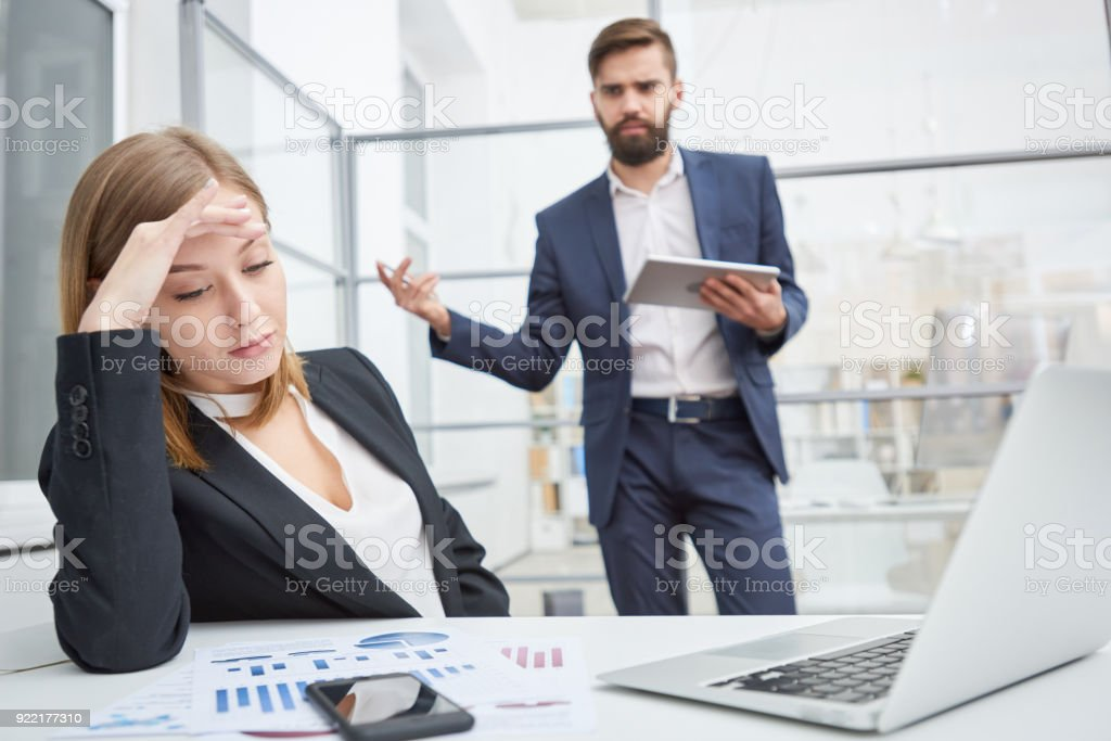 Displeased boss berating indifferent employee stock photo