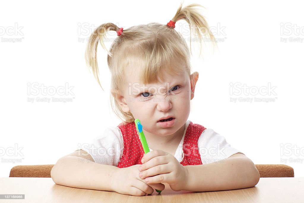 displeased child with toothbrush stock photo