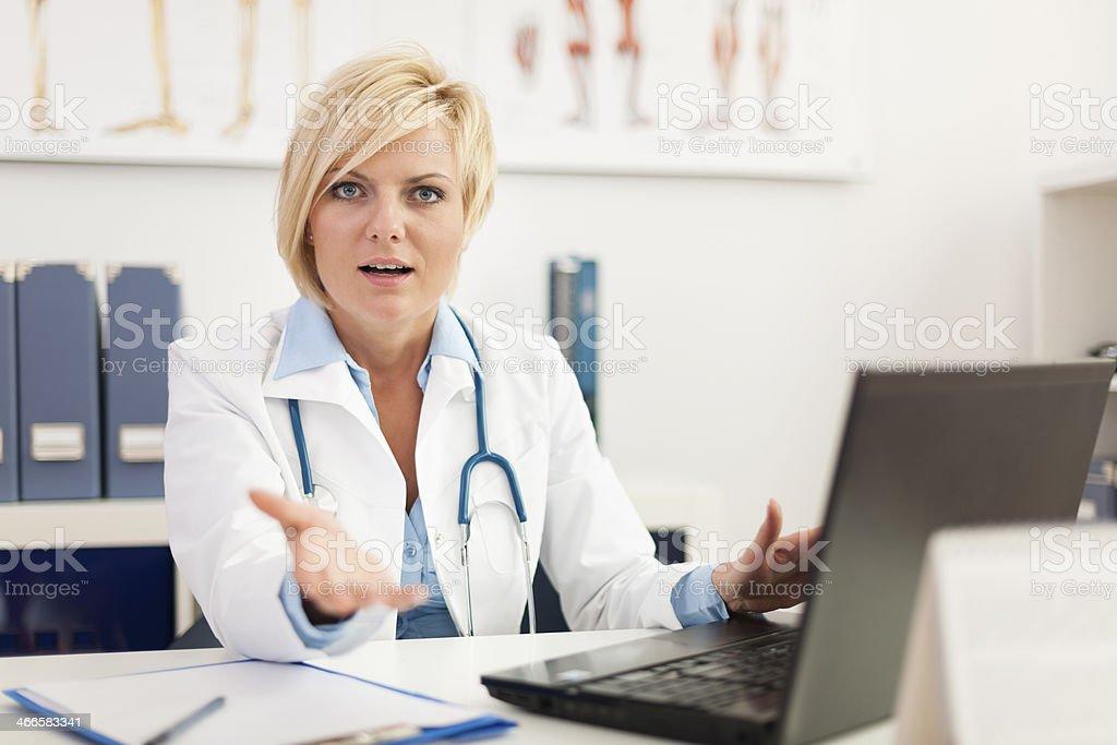 Displeased female doctor in her office stock photo