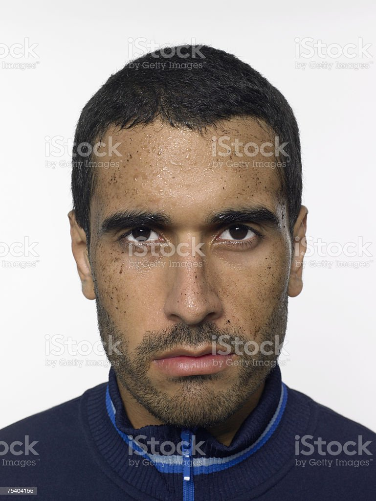 Displeased man with dirt on his face royalty-free stock photo