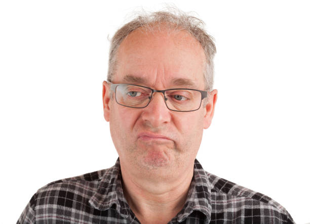 Displeased Man is displeased about something antagonize stock pictures, royalty-free photos & images