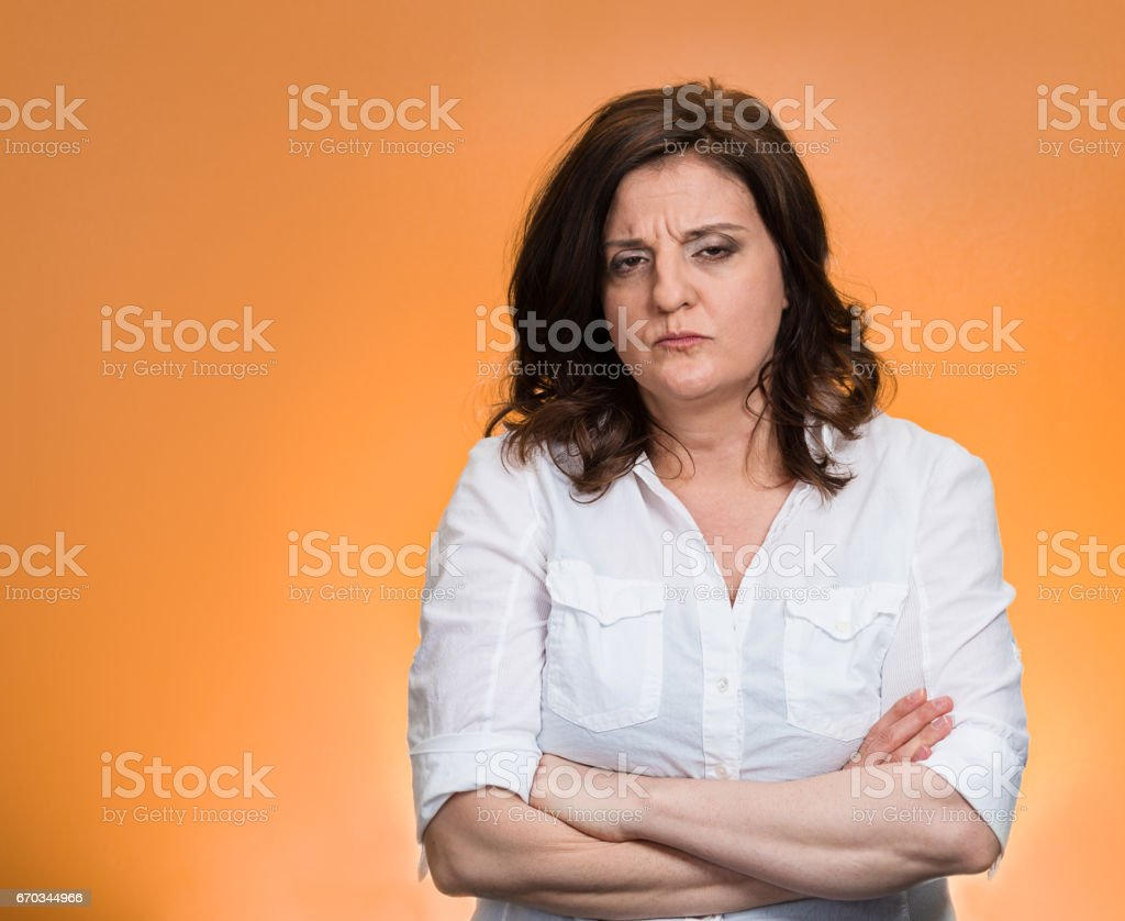 displeased pissed off angry grumpy pessimistic woman with bad attitude, stock photo
