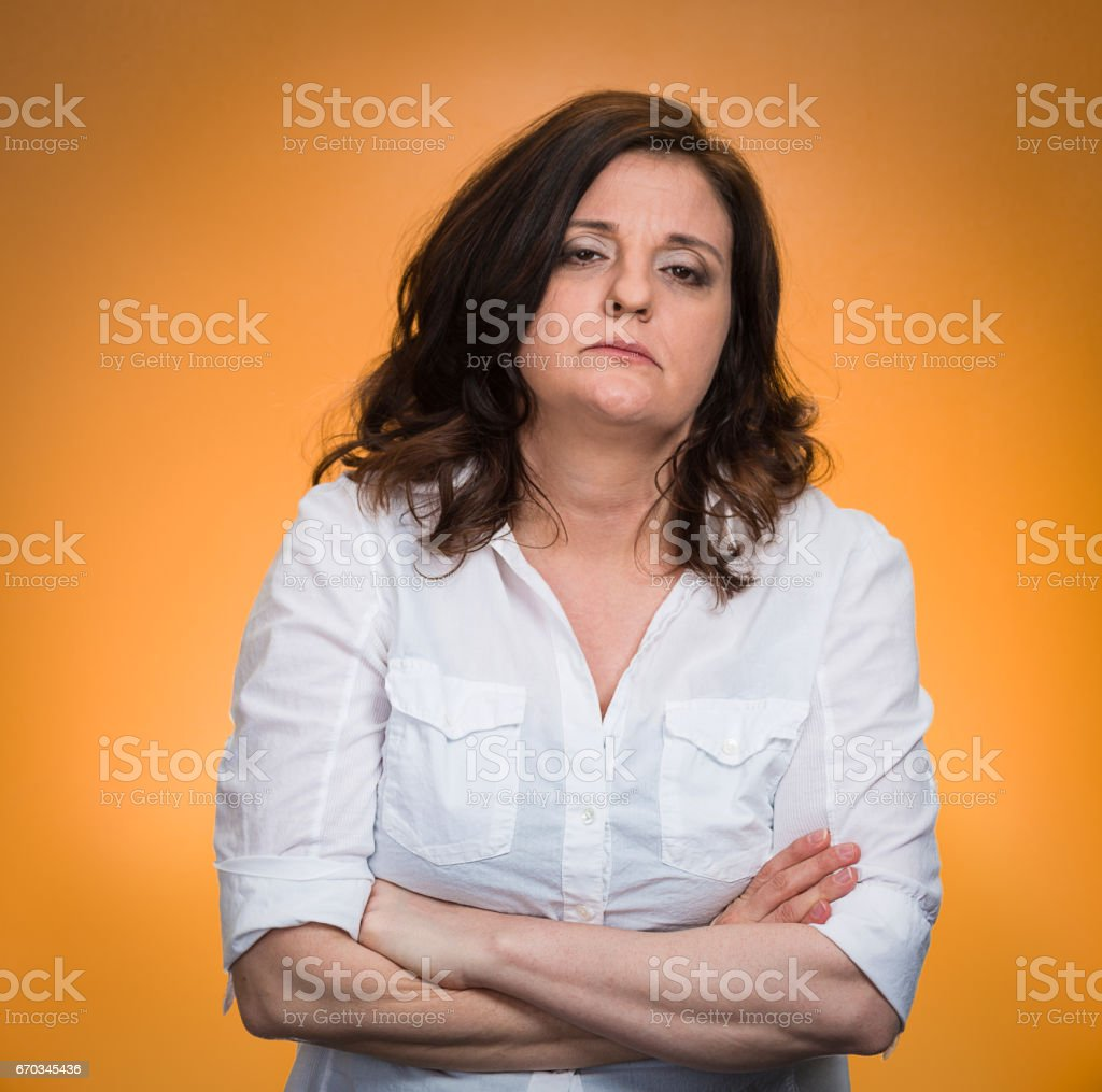 displeased pissed off angry grumpy woman with bad attitude, arms crossed stock photo