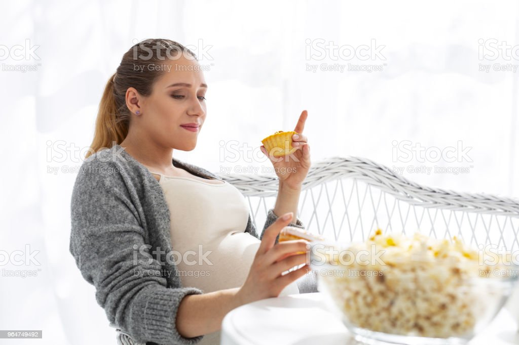 Displeased pregnant woman having doubts royalty-free stock photo