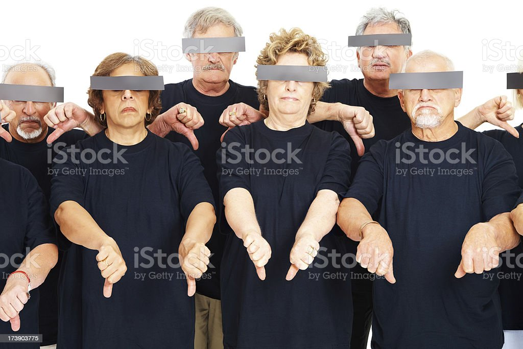 Displeased seniors citizens showing thumbs down sign stock photo