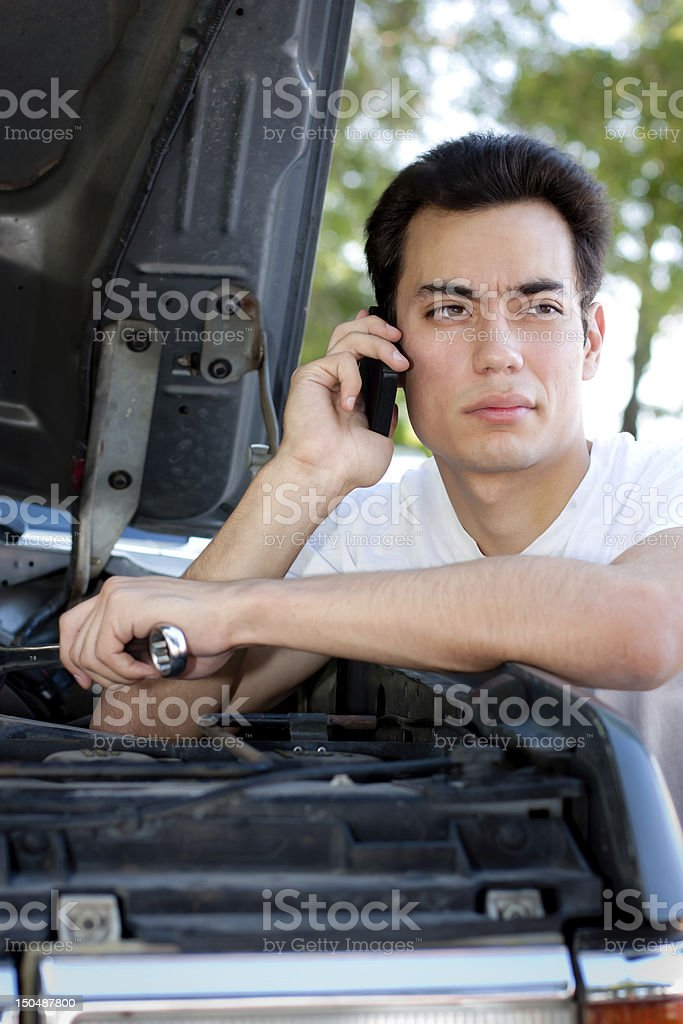 Displeased Young Man Calling For Help stock photo