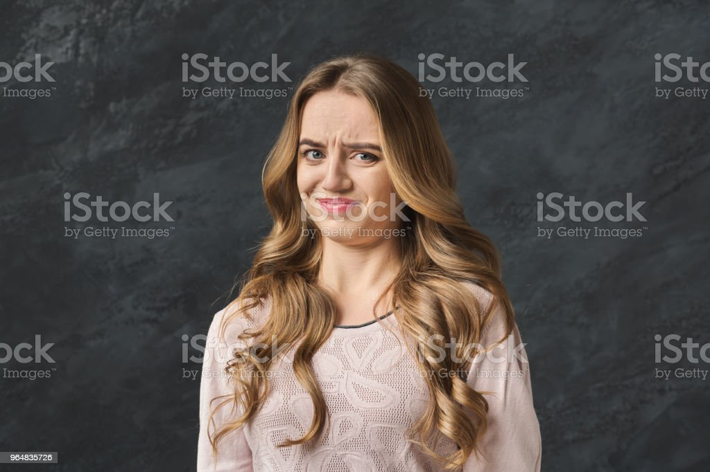Displeased young woman raising hands royalty-free stock photo