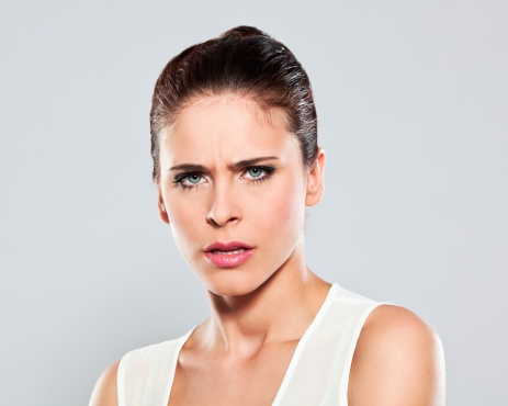Displeased Young Woman Studio Portrait Stock Photo - Download Image Now