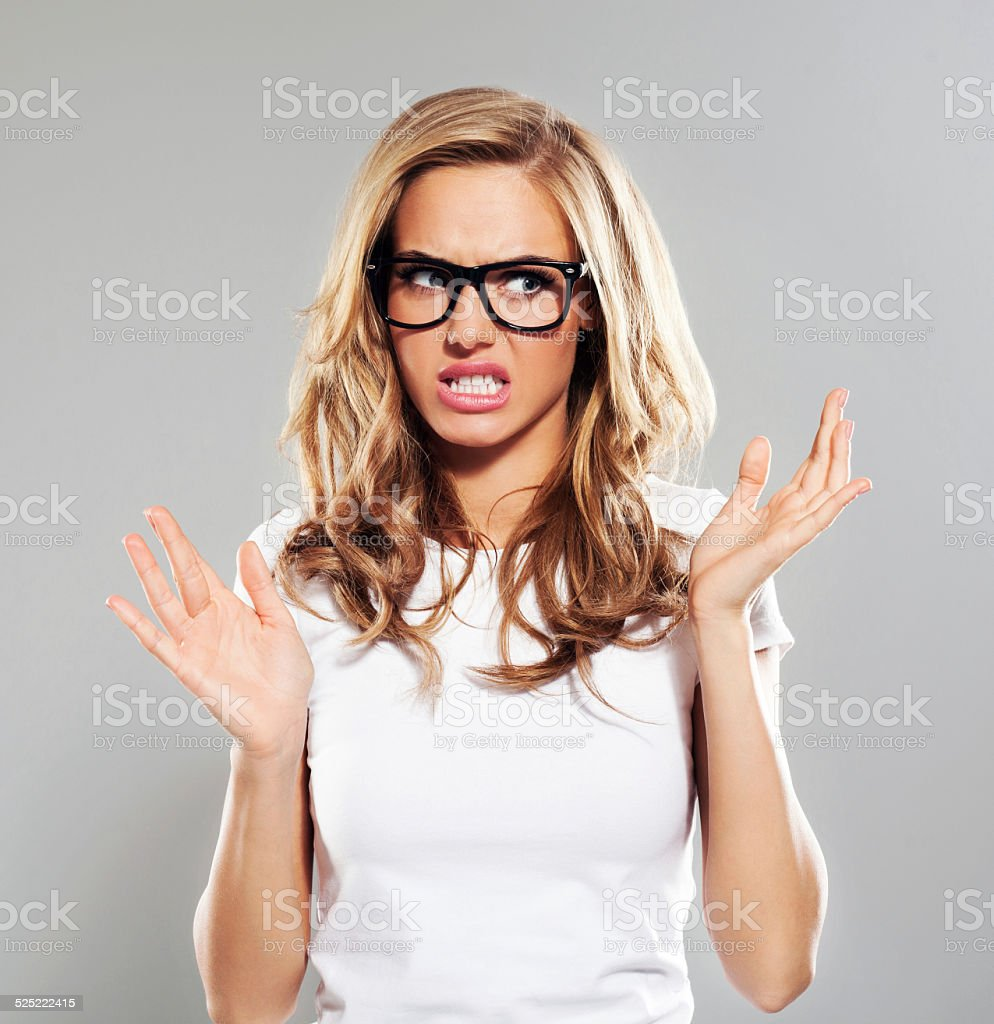 Displeased young woman, Studio Portrait stock photo