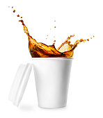 disposable white paper cup isolated on white background. Coffee splash. Take away cup of coffee. Coffee to go