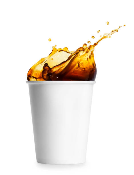 disposable cup with coffee splash disposable white paper cup isolated on white background. Coffee splash. Take away cup of coffee. Coffee to go spilling stock pictures, royalty-free photos & images
