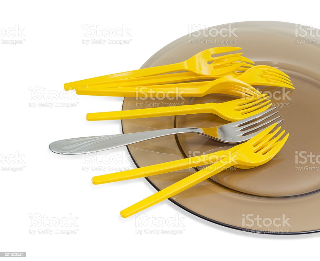 Disposable forks and one stainless steel fork on glass dish Lizenzfreies stock-foto