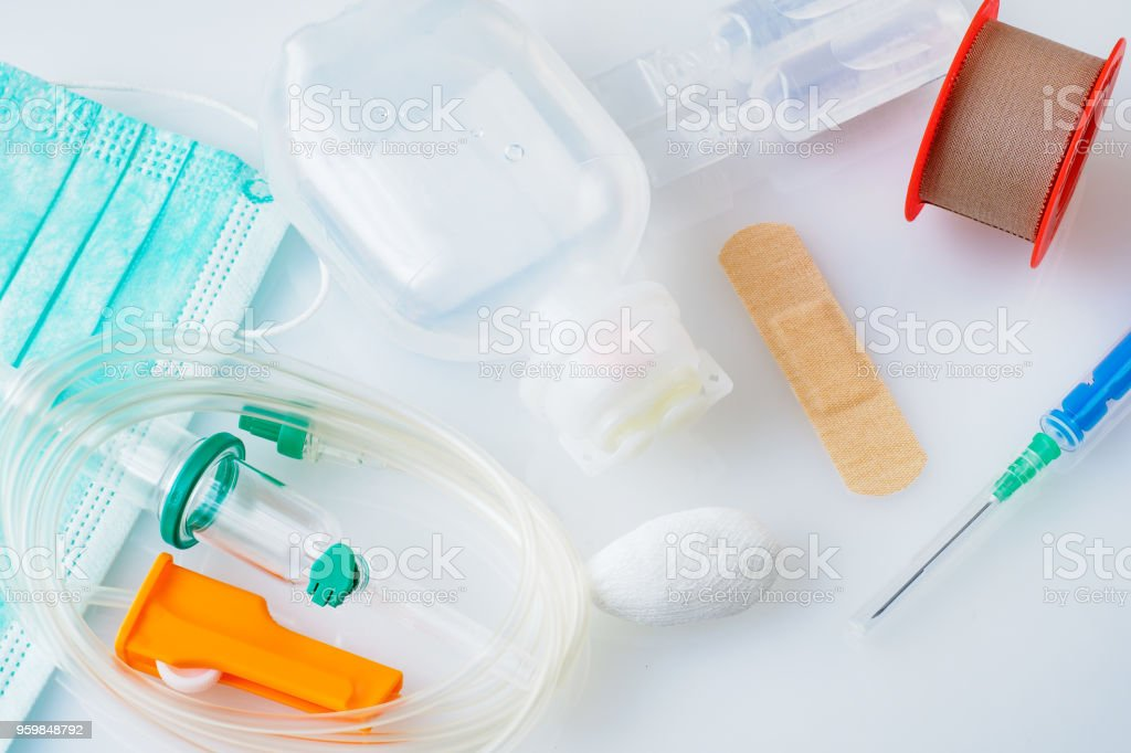Disposable infusion set and Syringes for medical, health care or pharmacy themes. Medical environment. stock photo