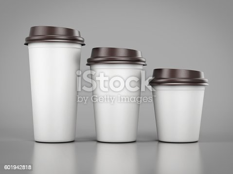 istock Disposable plastic cups of different sizes standing in a row. 601942818