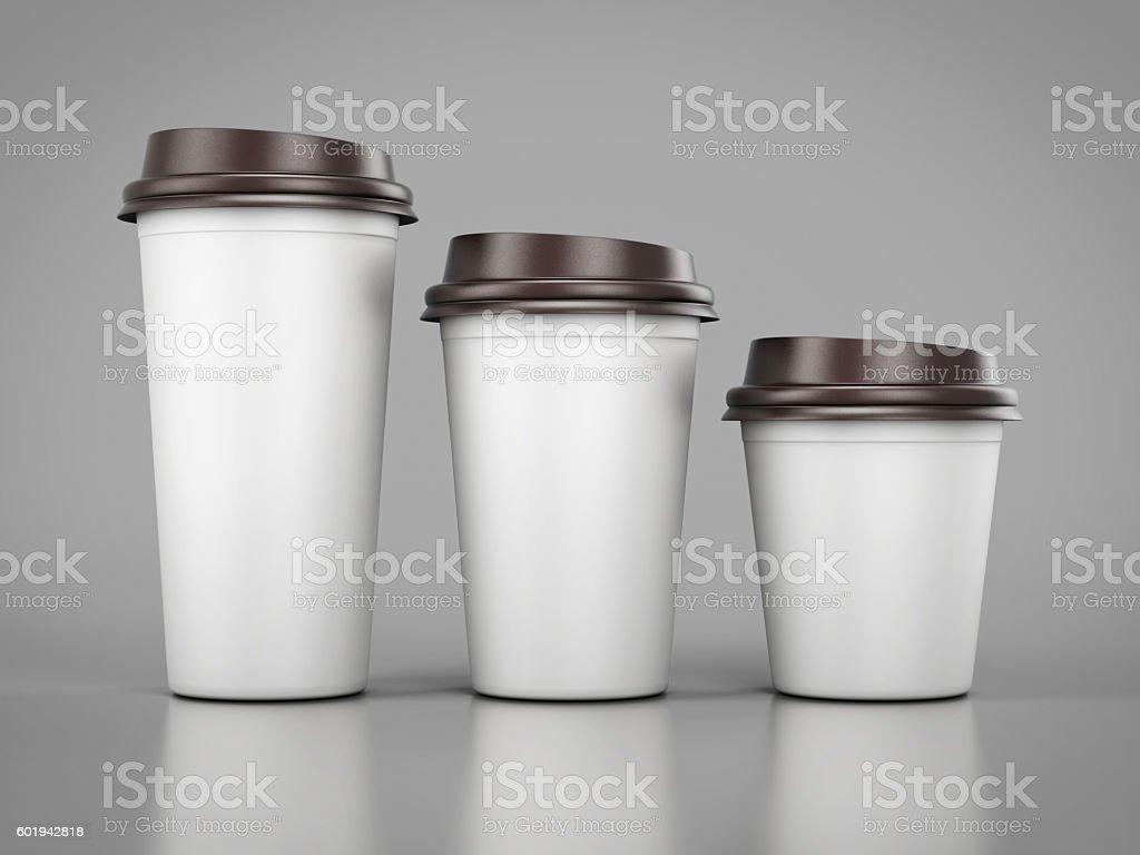Disposable plastic cups of different sizes standing in a row. stock photo