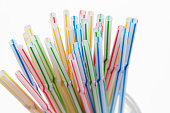 Plastic straws. Single use plastic, environmental issue, plastic pollution. Dining and party supplies.