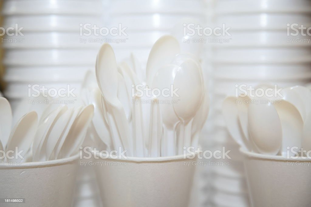 Disposable plastic utensils cups and spoons stock photo