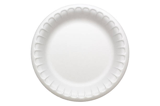 Disposable Plate A disposable styrofoam plate, isolated on white.  Styrofoam has a strange texture when viewed up close that may be confused for noise or banding, but this is how it actually looks. polystyrene stock pictures, royalty-free photos & images