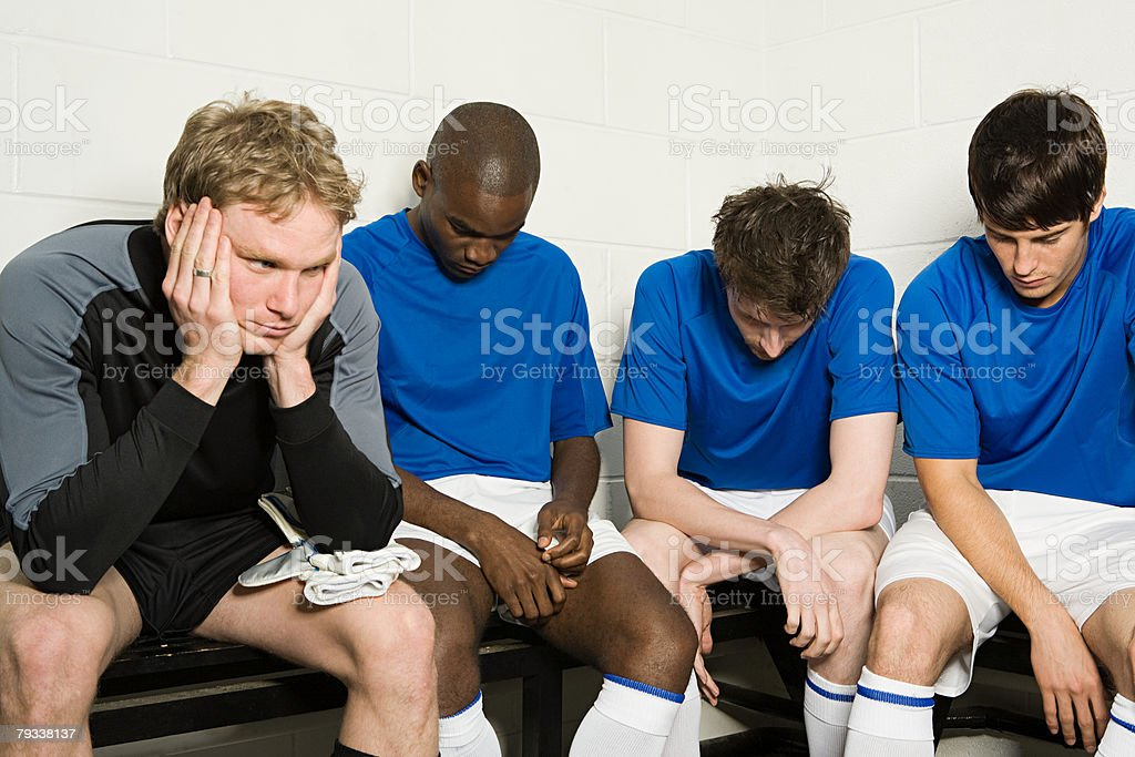A disppointed football team 免版稅 stock photo