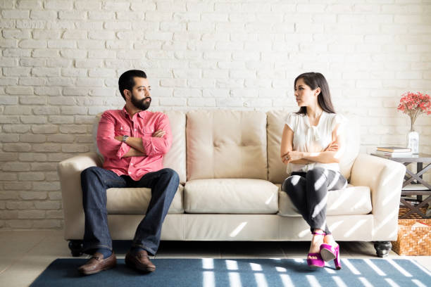 disputed couple staring at each other with anger - fighting stock photos and pictures