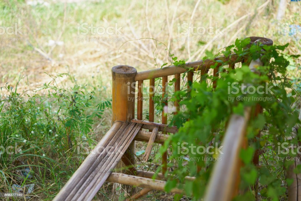 disrepair bamboo chair. old chair in waste lands. stock photo