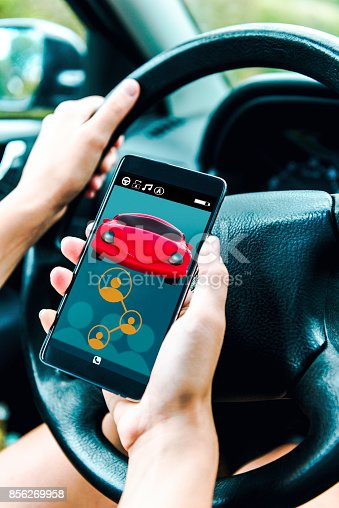 istock Disruptive app for car sharing displayed on mobile phone inside car 856269958