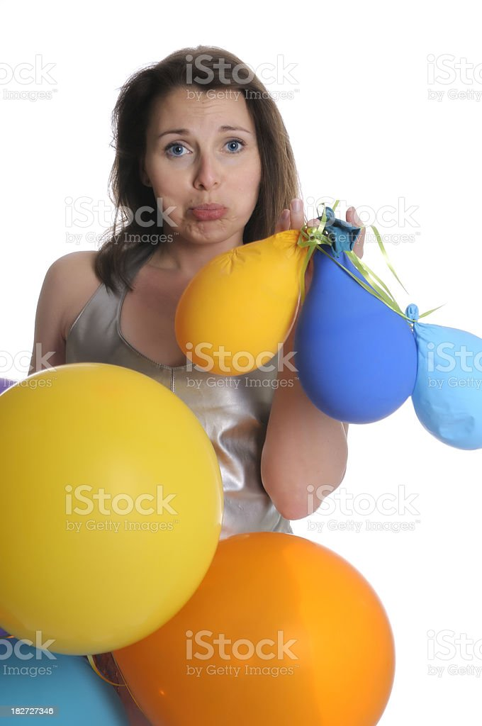 Dissappointed woman with deflated balloons royalty-free stock photo