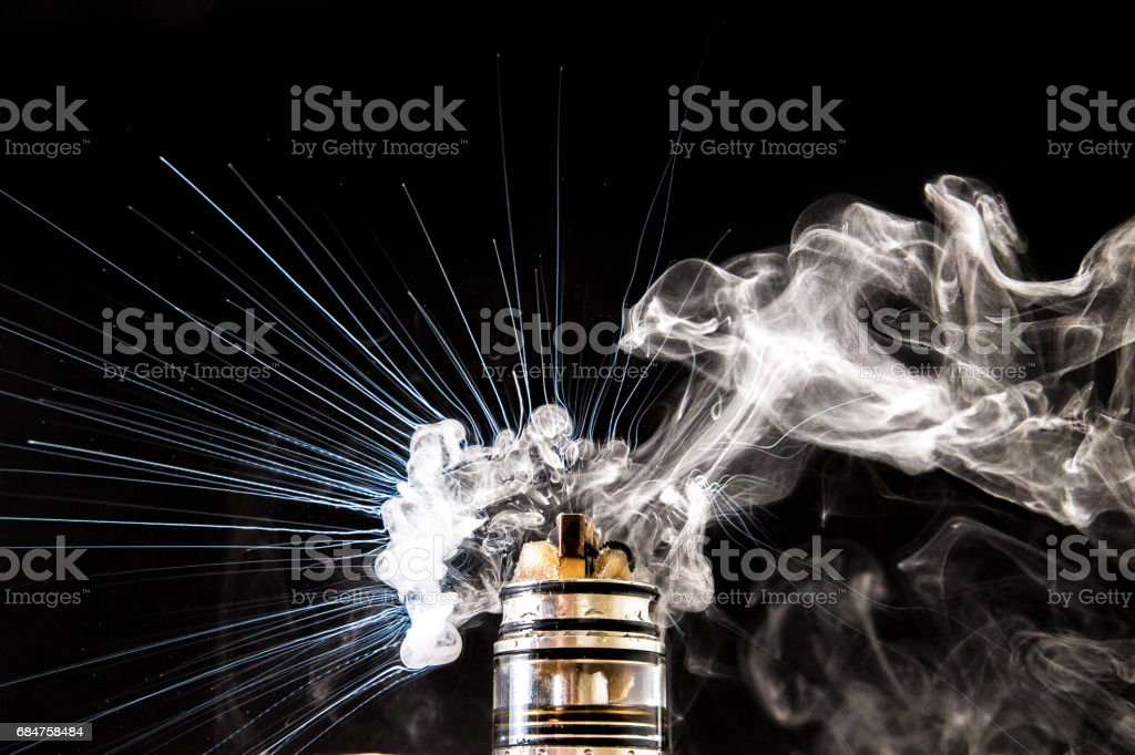 Dissassembled electronic Cigarette vape cloud stock photo
