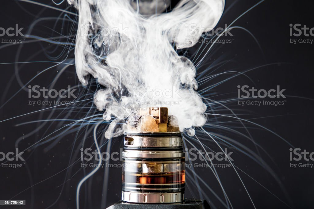 Dissassembled electronic Cigarette vape explosion stock photo