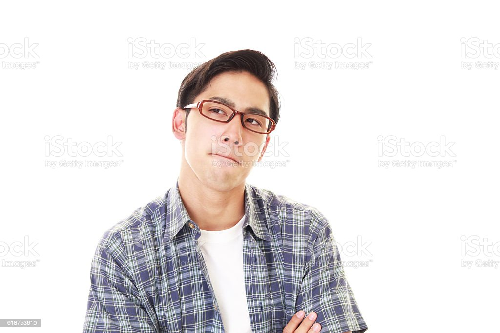 Dissatisfied Asian man stock photo