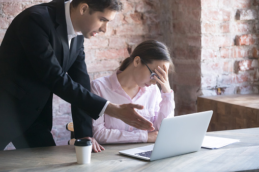 istock Dissatisfied boss and tired woman 1036273952