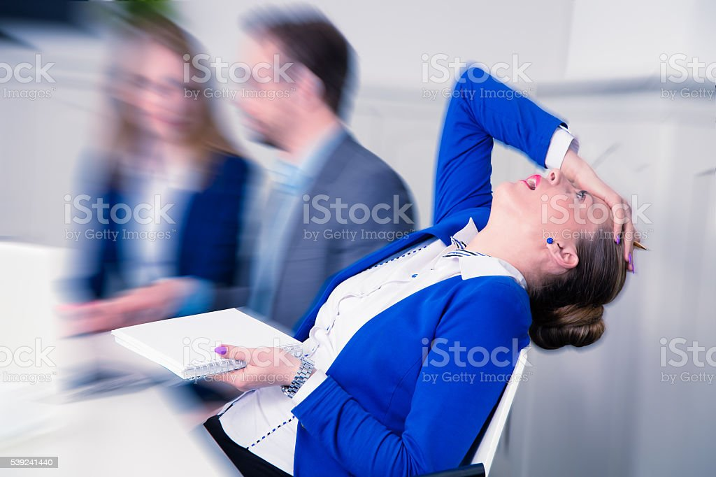 Dissatisfied businesswoman on a meeting royalty-free stock photo