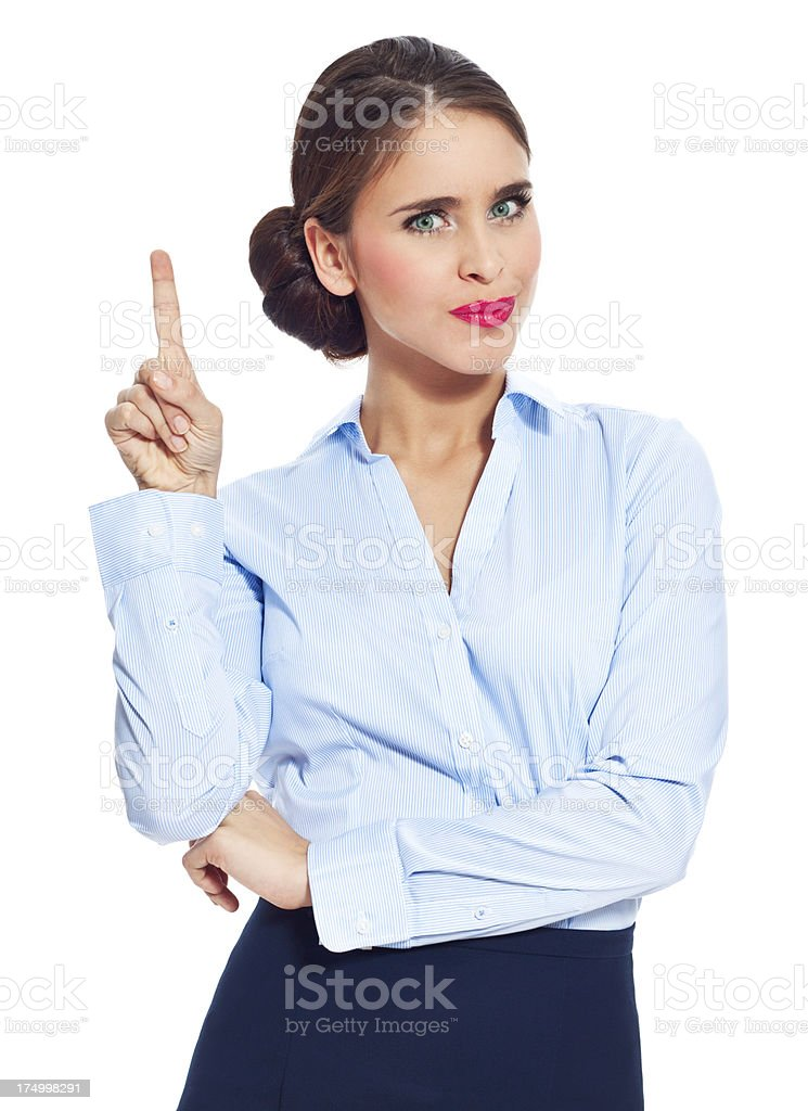 Dissatisfied businesswoman Portrait of disappointed businesswoman wagging her index finger. Studio shot on white background. 20-24 Years Stock Photo