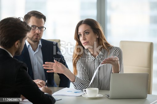 Dissatisfied executive manager having conflict with employee about financial report mistake, disgruntled clients claim complaint disputing about bad contract terms meeting lawyer, legal fraud concept