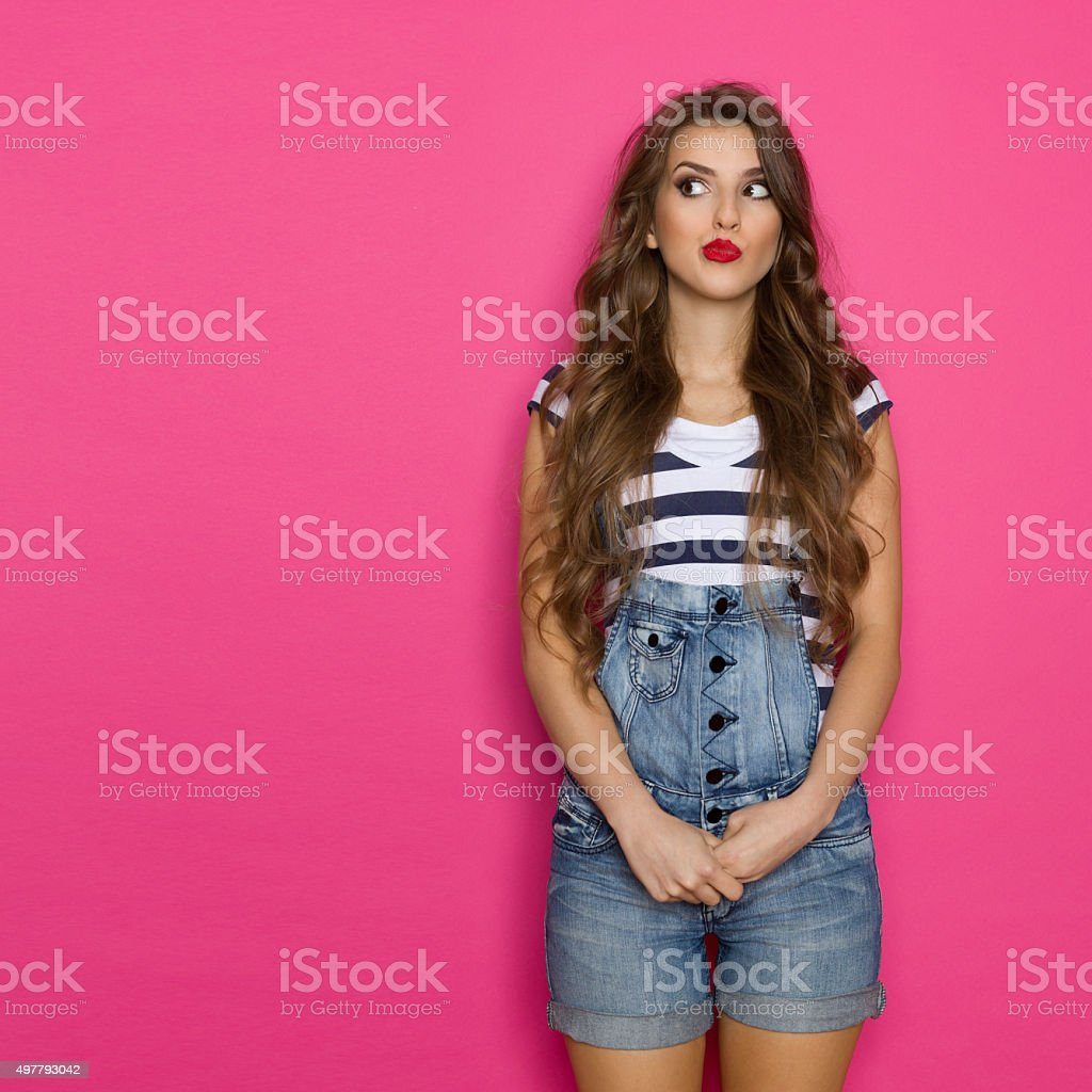 Dissatisfied Grimacing Woman stock photo