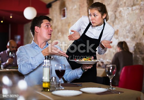 istock Dissatisfied man in restaurant 942130252