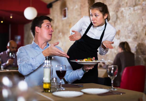dissatisfied man in restaurant - rabbia emozione negativa foto e immagini stock