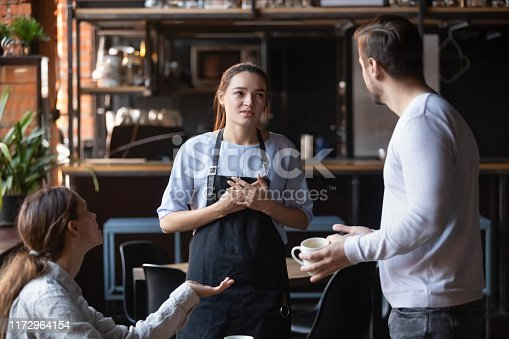 istock Dissatisfied restaurant clients complaining about bad service 1172964154